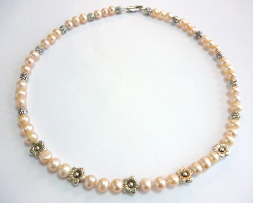 Necklace of White Pearls with Silver Flower Charm Beads.